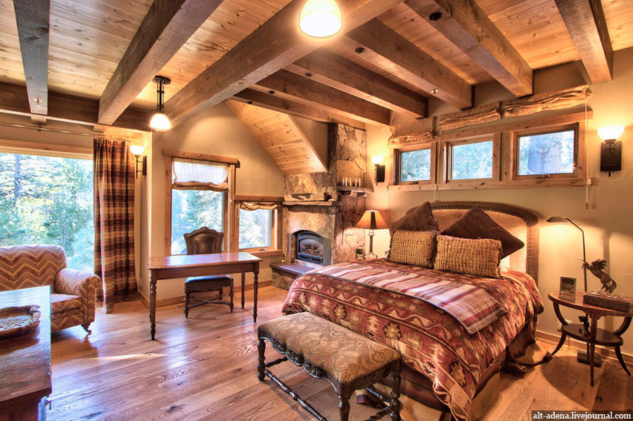 bedroom in house from wood in rustic style